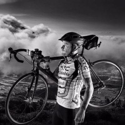 Matt Pritchard holding a bike - photo credit to Richard P Walton