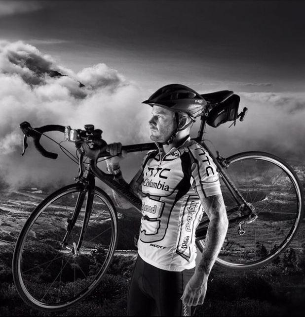 Matt Pritchard holding a bike